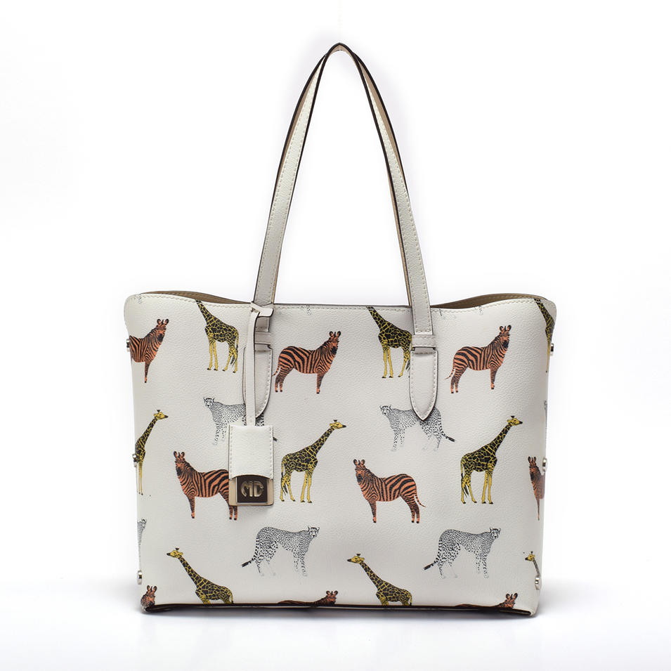 Printed leather tote in stock handbag